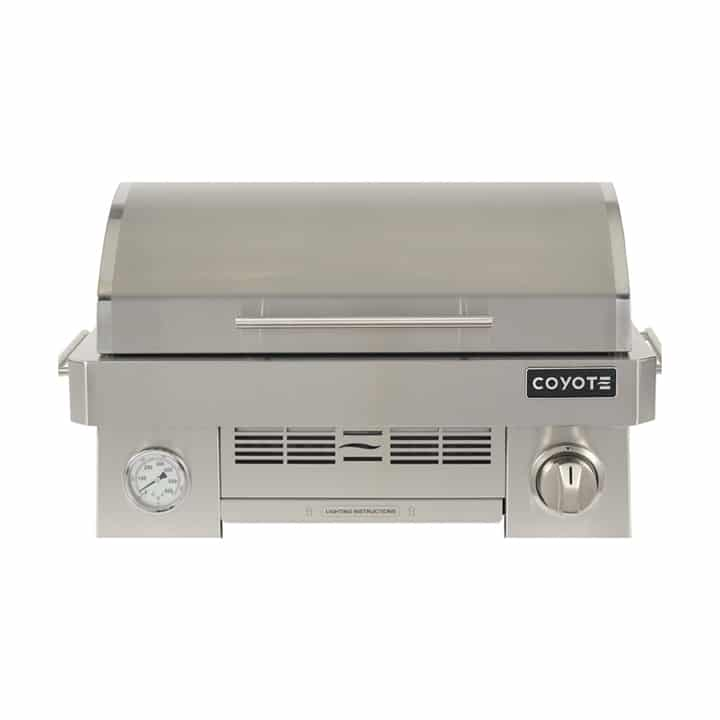 Coyote Portable BBQ C1PORTLP in Stainless Steel color showcased by Corbeil Electro Store