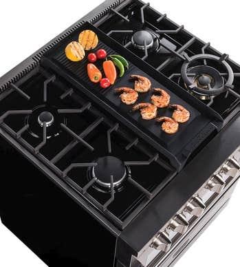 Blomberg Accessoire de cuisson en couleur Noir présenté par Corbeil Electro Store